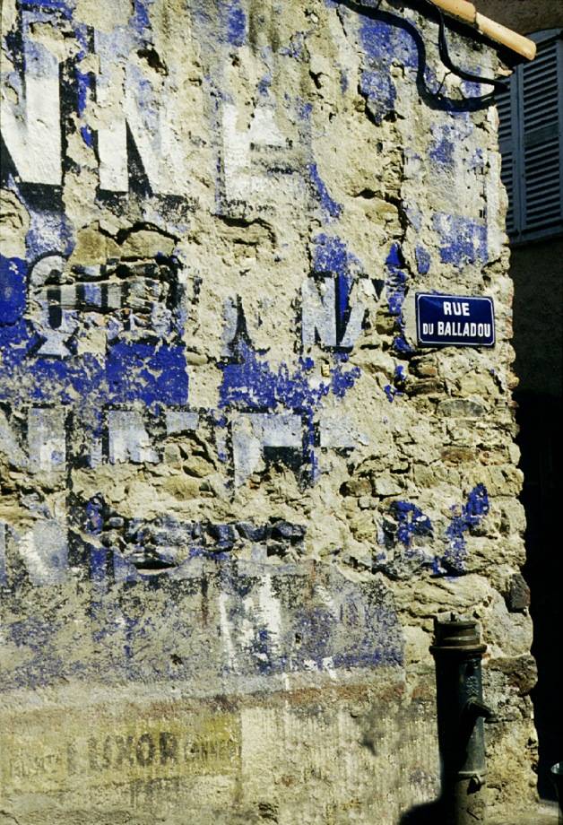 Old advertising on wall - Grimaud, France